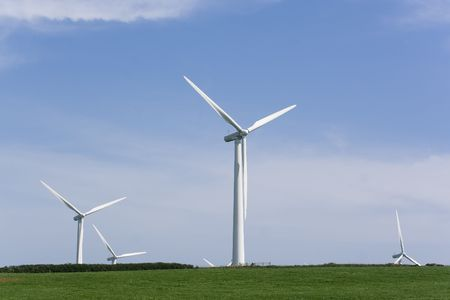 wind generator turbines with sky as background photo