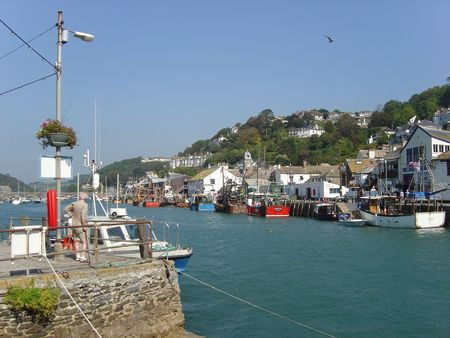 quayside: Looe fishing harbour with boats on quayside Stock Photo