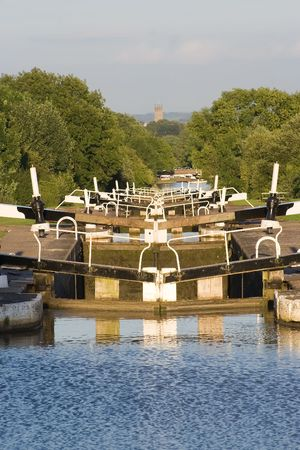 canal lock: flight on English canal lock gates in evening sunshine