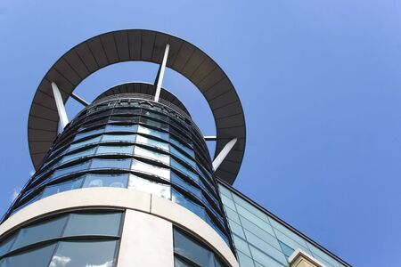 modern building in Birmingham, England with blue sky background photo
