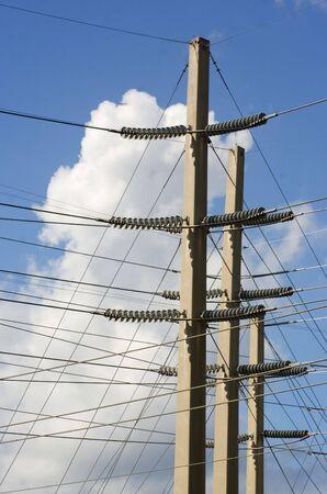 insulators: power lines and insulators on concrete masts