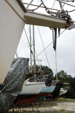 ashore: boats in line ashore at storage boatyard