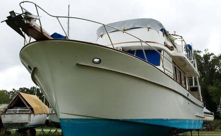 ashore: luxury power boat ashore in boatyard