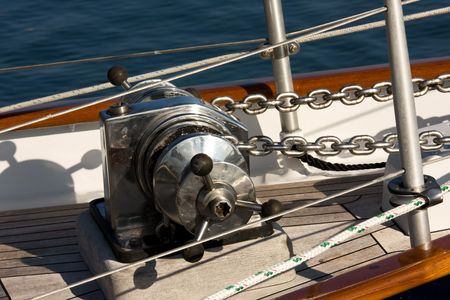 windlass: stainless steel anchor windlass on bow of sailing yacht Stock Photo