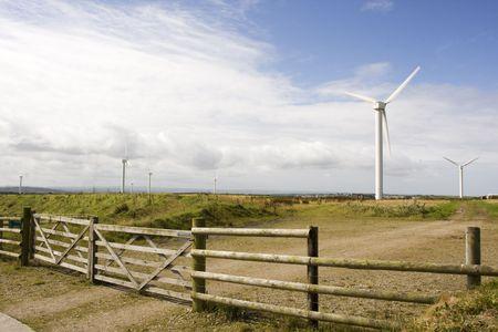 electricity generator: wind turbine electricity generator towers in summer