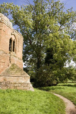 footpath around old castle ruins in summer photo