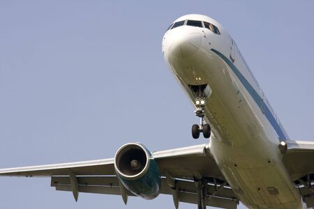 undercarriage: twin engine jet on approach to land Stock Photo