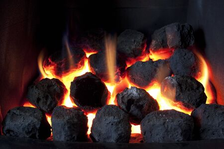 gas fire: gas fire burning with artificial coals