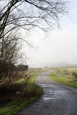winding path through a park in winter Stock fotó