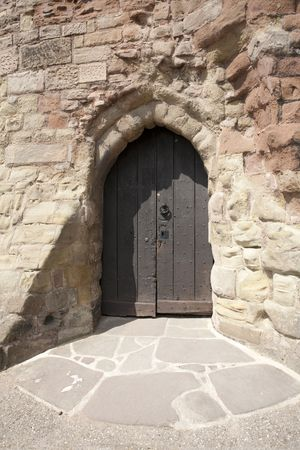 old wooden door to an English castle photo