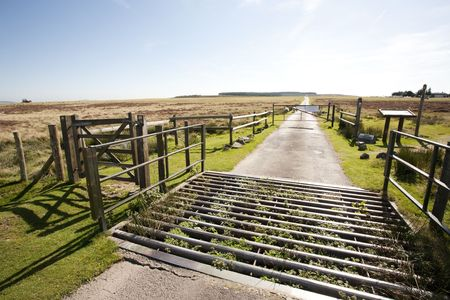 cattle grid: cattle grid on a straight moorland road