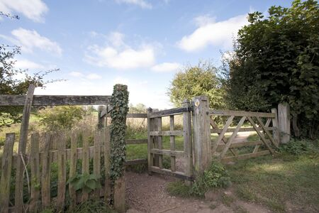 ble: wooden gate on path of a country walk