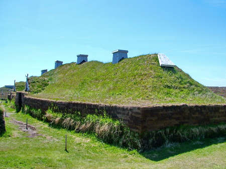 Newfoundland, CA: L'Anse aux Meadows on June 24, 2011. A re-creation of a Viking timber-and-sod-longhouse. L'Anse aux Meadows is the first and only known viking archaeological site in North America. 에디토리얼