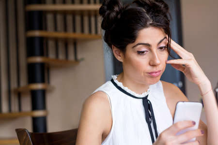 Portrait of young sad annoyed woman, receiving bad sms