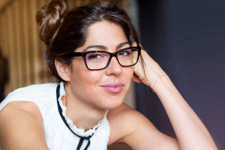 Portrait of beautiful young smiling woman with modern eyeglasses with black frame