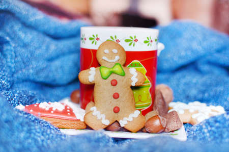 Smiling gingerbread man and christmas red tea cup for christmas