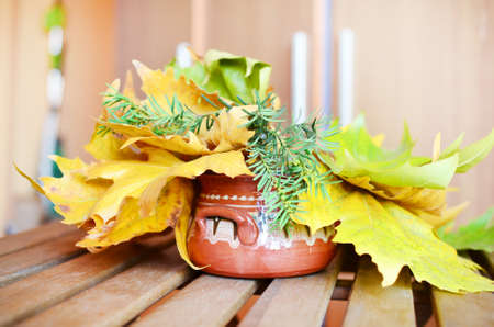 hand made vintage vase with autumn leaves for home decoration