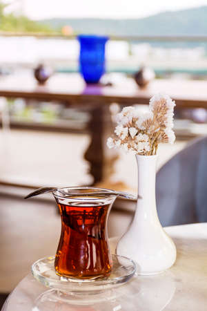Turkish tea with authentic glass cup on a table in a coffee bar Stock Photo