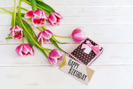 Tulips Flower On Wooden Background With Happy Birthday Card Stock