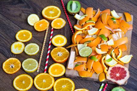 Assorted cut citrus fruits on wooden background Banco de Imagens