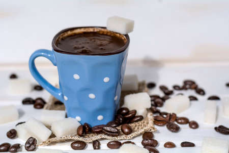 coffee cup with white sugar cubes. Unhealthy living concept