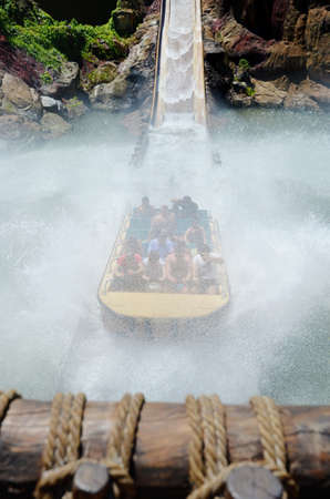 SALOU, SPAIN - MAY, 19,2017: Falling Down Water Ride with People at the Amusement Park Port Aventura near Barcelona.Tutuki Splash water ride is  in the Polynesia section of the park Editorial