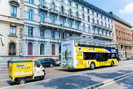 MILAN, ITALY - JUNE 28, 2018: Open Tour Double Decker Yellow Touristic Bus.City Sightseeing Bus