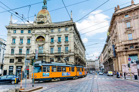 MILAN,ITALY -JUNE 27,2018 :Historic Tram on the Street in Milan,Italy .Street Traffic with Yellow Trolley Car