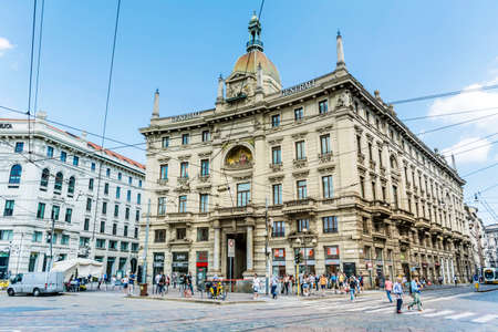 MILAN,ITALY -JUNE 27,2018 :Main  Street with Antique Traditional Buildings in the Downtown of Milan ,Italy.Traffic in  the Fashion Capital of Italy Editorial