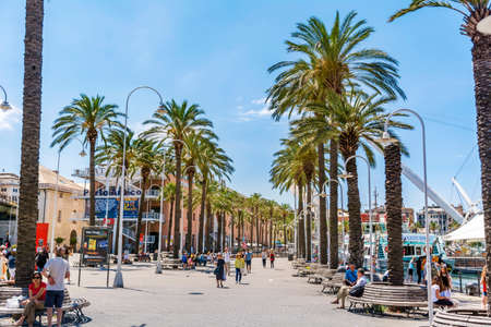 GENOA,ITALY -JUNE 27,2018 :Promenade Street with Palms and Buildings near the Old Port in Genoa.Waterfront Area  Designed by Renzo Piano