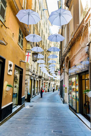 GENOA,ITALY -JUNE 27,2018 : White Umbrellas Hanging Above the Street in Genoa ,Italy Editorial
