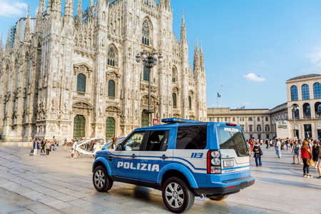 MILAN, ITALY - JUNE 27,2018:Italian Police Blue Car with Big Writing POLIZIA Parked in Front of the Duomo Cathedral in Milan