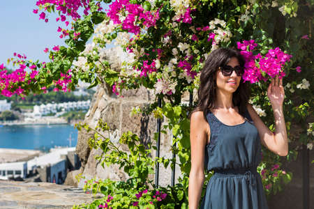 Beautiful Woman Smelling Bougainvillea Flowers Outdoor