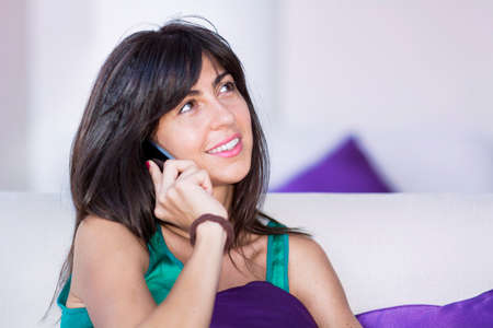 Portrait of Beautiful Smiling  Woman Talking on the Phone at Home Zdjęcie Seryjne
