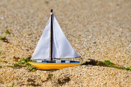 Toy Boat on the Beach . Summer Sea Vacation Concept