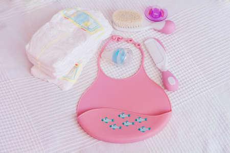 Pink Plastic Baby Bib ,Hairbrush and Diapers Zdjęcie Seryjne