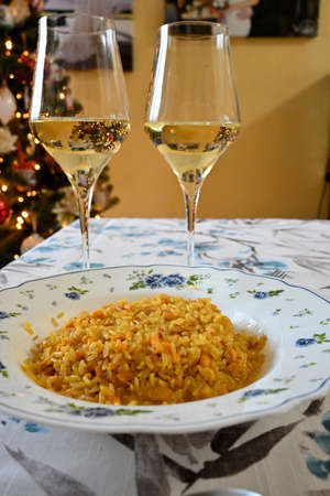 aperitif for two people with Christmas tree in the background