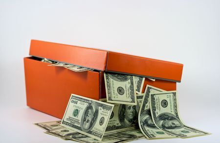 a Shoe Box full of Money is overflowing with cash.  This is no way to keep your money safe these days