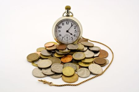an antique pocket watch with gold fob surrounded by coins of the world photo