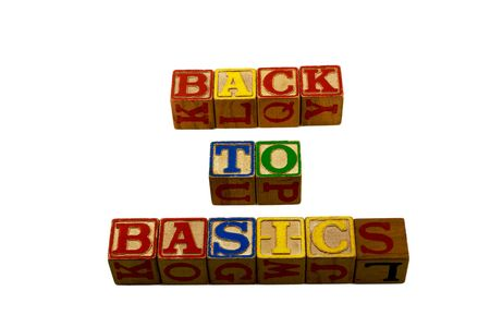 Vintage alphabet play wooden blocks layed out in three rows spelling back to basics Stock Photo