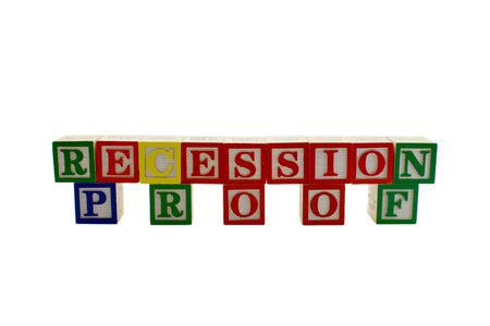 Vintage alphabet blocks spelling out the word recession proof