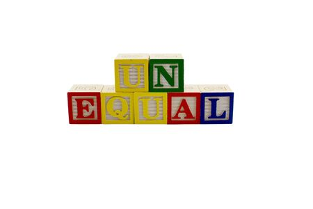 unequal: Vintage alphabet blocks spelling out the word unequal Stock Photo