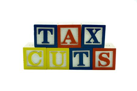 A series of Wooden Alphabet Blocks Spelling Tax Cuts
