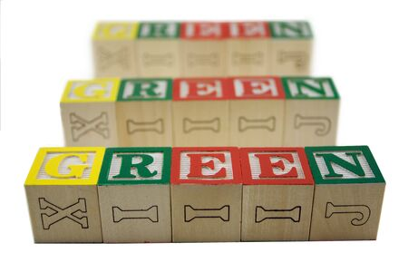 Toy alphabet blocks spelling 3 rows of fading Green Stock Photo - 4685297