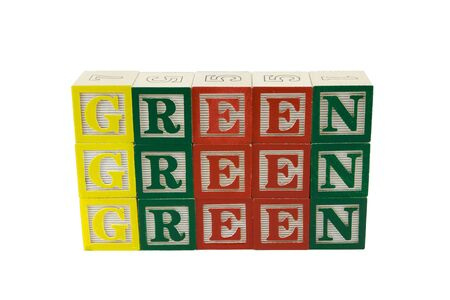 Toy alphabet blocks spelling a wall of three rows of Green