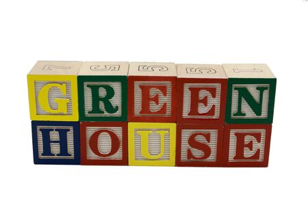 economic issues: Wooden toy alphabet blocks spell out Green House Stock Photo