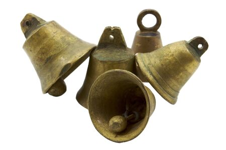 Small brass bells stacked  and leaning on one another
