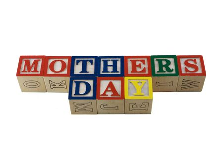 lined up: wooden alphabet blocks lined up in a row spelling Mothers Day Stock Photo