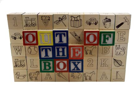 a wall of alphabet wooden blocks with the words out of the box extended  photo