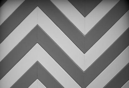 a black and white chevron or zig zag wood design of a garage door on an older home photo